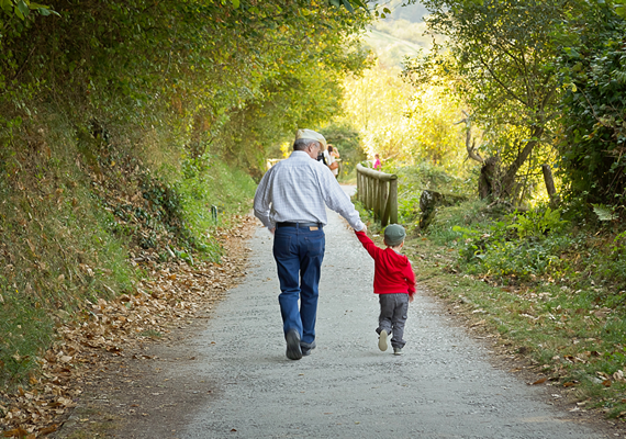 grandfather-walking-with-grandson-570x400